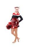 Jeune majorette professionnelle avec le pom-pom dans votre main posant au studio Image stock