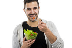Jeune mangeur d'hommes une salade photos stock