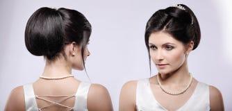 Jeune mariée magnifique avec les cheveux foncés dans la robe de mariage luxuious photographie stock libre de droits