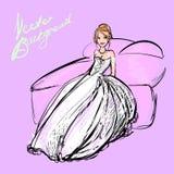 Jeune mariée sur le lit Photographie stock