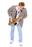 Jeune musicien dans une jupe checkered Image stock