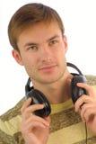 Jeune musique d'écouteurs de type Photographie stock