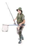 Jeune pêcheur retenant un filet de pêche Images libres de droits