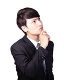 Jeune pensée d'homme d'affaires Photographie stock libre de droits