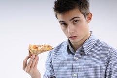 Jeune pizza mangeuse d'hommes Image libre de droits