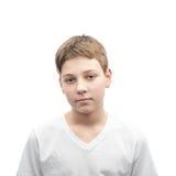 Jeune portrait de garçon d'isolement Photographie stock libre de droits
