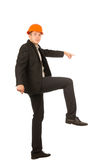 Jeune pose masculine de Lifting One Leg d'ingénieur Images stock