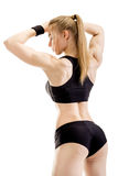 Jeune pose musculaire de femme Image stock