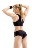 Jeune pose musculaire de femme Photo stock