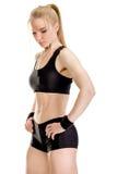 Jeune pose musculaire de femme Image libre de droits