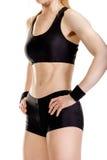 Jeune pose musculaire de femme Photographie stock