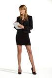 Jeune position attrayante de fille d'affaires Image stock