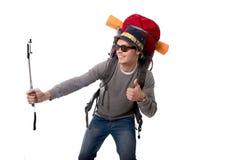 Jeune randonneur atractive de voyageur prenant la photo de selfie avec le sac à dos de transport de bâton prêt pour l'aventure photo libre de droits