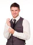 Jeune rectification d'homme d'affaires images stock