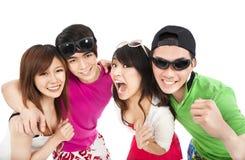 Jeune rire heureux de groupe Photos stock