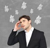 Jeune séance de réflexion d'homme d'affaires Images stock