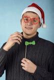 Jeune Santa Claus dans un masque Photographie stock libre de droits