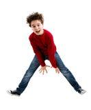 Jeune sauter de garçon image stock