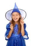Jeune sorcière avec une baguette magique magique Images stock