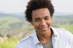 Jeune sourire africain d'homme Image stock