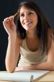 Jeune sourire d'étudiante Photographie stock