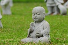 Jeune statue de Bouddha Photographie stock libre de droits