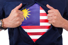 Jeune supporter ouvrant sa chemise et montrant au drapeau son compte Photo libre de droits