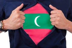 Jeune supporter ouvrant sa chemise et montrant au drapeau son compte Photos libres de droits