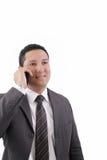 Téléphone portable parlant d'homme d'affaires Image libre de droits