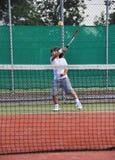 Jeune tennis de pièce de garçon Photo stock