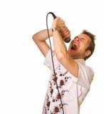 Jeune type avec un microphone photo stock