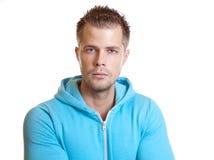 Jeune type beau utilisant un hoodie Photographie stock