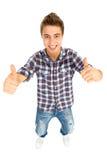 Jeune type frais avec des pouces vers le haut Images libres de droits