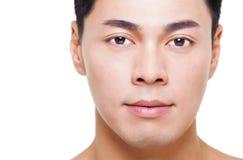 Jeune visage asiatique d'homme d'isolement sur le blanc Image libre de droits