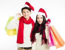 jeunes ajouter aux achats de Noël Photographie stock libre de droits