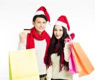 jeunes ajouter aux achats de Noël Image libre de droits