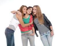 Jeunes années de l'adolescence posant sur le blanc. images libres de droits