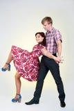 Jeunes beaux couples dans la danse Image stock