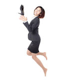 Jeunes chaussures heureuses de saut et de jet de femme d'affaires Photos stock