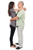 Jeunes couples attrayants d'isolement sur le blanc Images libres de droits