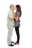 Jeunes couples attrayants d'isolement sur le blanc Image stock
