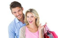 Jeunes couples attrayants tenant des paniers Image stock