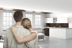 Jeunes couples caucasiens dans la cuisine moderne Photographie stock