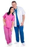 Jeunes couples de médecin et d'infirmière Photographie stock libre de droits