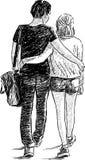 Jeunes couples de marche Photographie stock libre de droits