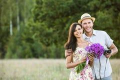 Jeunes couples de sourire Photo stock