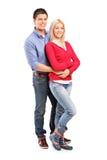 Jeunes couples de sourire dans une étreinte Image stock