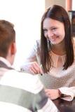 Jeunes couples en café Images stock