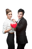 Jeunes couples gais d'affaires tenant le coeur rouge Images libres de droits