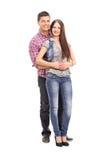 Jeunes couples gais posant sur le fond blanc Image stock
